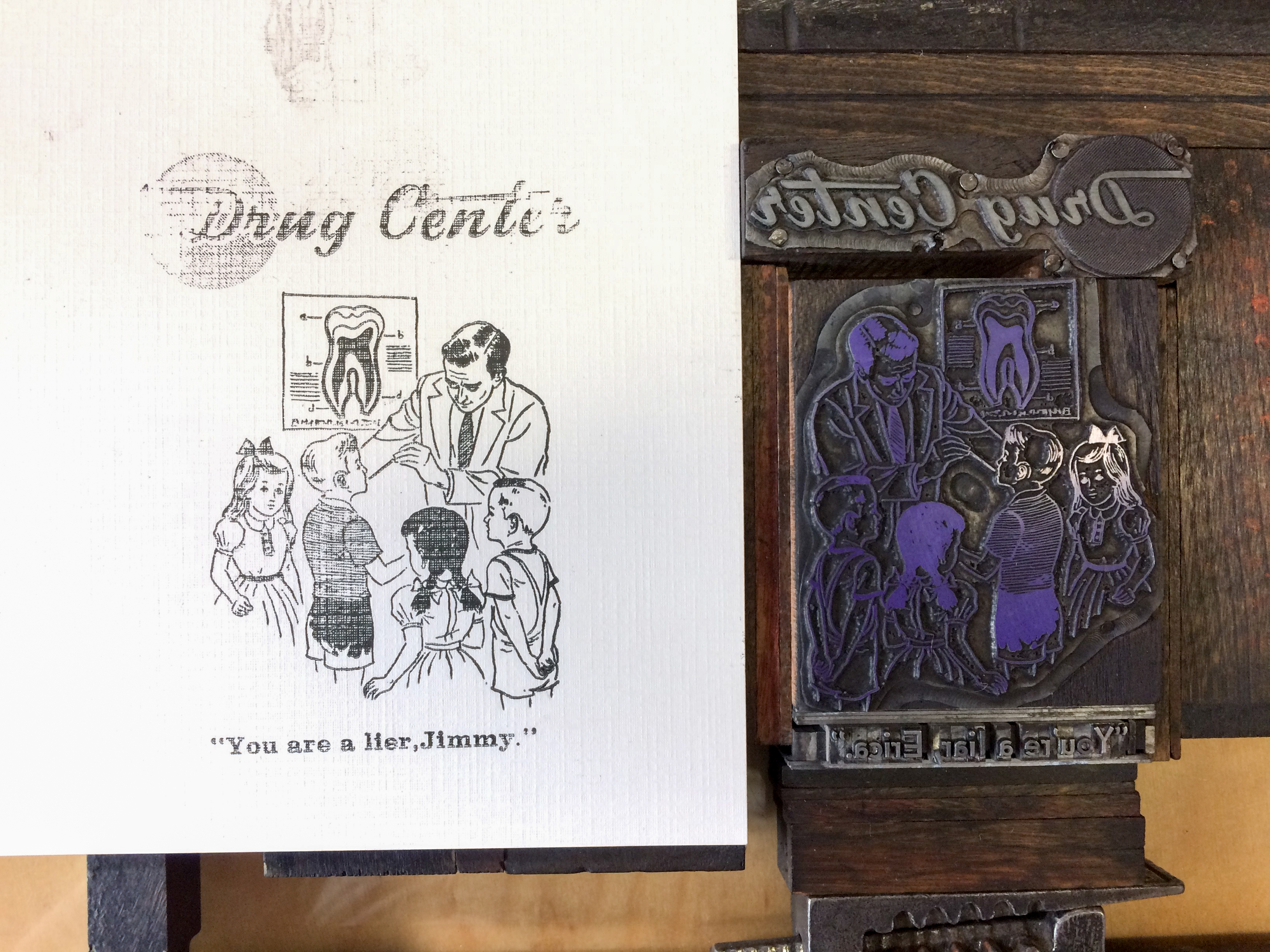 "Lockup of image and type in a letterpress chase. Has the words Drug Center with a image of a dentist and a group of children. The type underneath the image reads ""You're a liar, Jimmy"""